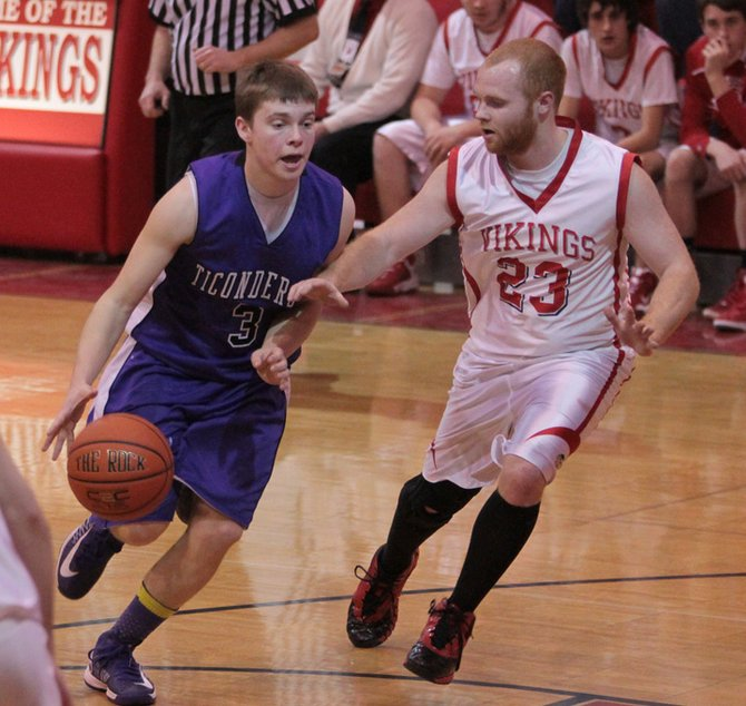 Mike Graney of Ticonderoga drives against Moriah's Mike Mero. Moriah posted a 55-43 win against Ticonderoga in Champlain Valley Athletic Conference boys basketball play Jan. 3.