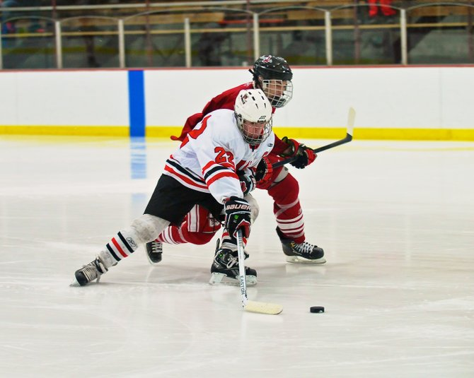 Baldwinsville forward Matt Zandri (22) protects the puck and tries to skate around a Central Square defender in Friday night's game. The Bees had a big weekend, topping the Red Hawks 3-1 as Zandri earned two assists, and going on to upset state no. 3-ranked Rochester McQuaid 2-0 a day later.