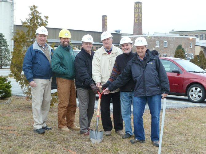 Joe and Peter Giancola stand next to PEGTV building committee members Tom Pour, President Carl Anderson, Tom Hurcomb and PEGTV Executive Director Mike Valentine as they get ready to break ground on a new addition to their Rutland headquarters located in the Howe Center. PEGTV recently signed a new 10-year lease with the Giancola family, owners of the complex.