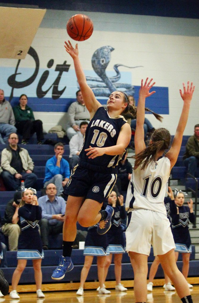 Skaneateles junior guard Nicole Beatson (10) finishes off a drive to the basket in Thursday night's game at Bishop Grimes. Beatson had six points as the Lakers held off a furious late rally by the Cobras to prevail 60-59 and move to 8-2 on the season.