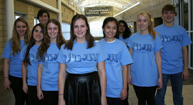 Interact club members wear the t-shirt they created fur Hurricane Sandy relief. Back row: Matthew Payne and Vimmy Bandaria. Front, left to right: Brenda Buff, Alex Welch, Mercedes Morales, Kelly Valente, Phoebe Glowacki, Kasia Rybczyk and James Hackler.