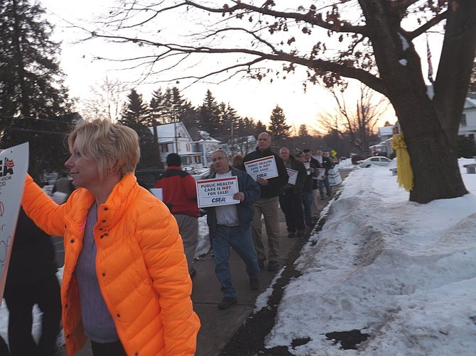 Angry citizens crowded picketed before the Saratoga County Supervisors public hearing Wednesday, Jan. 9, voicing their objections to the supervisors' plan to privatize the Maplewood Manor nursing home.