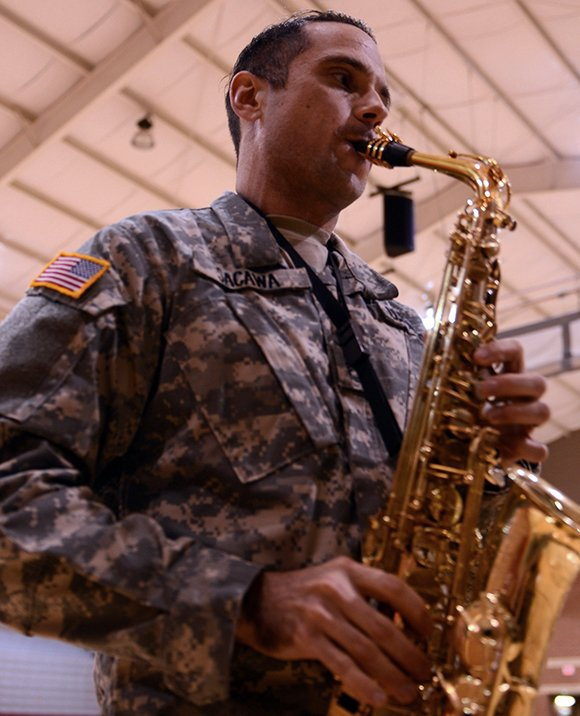 Sgt. 1st Class Brian Sacawa on Wednesday, Jan. 2, demonstrates a piece of music for the U.S. Army All-American Band at Benson Stadium in San Antonio. Sacawa was the woodwind conductor for the U.S. Army All-American Band.