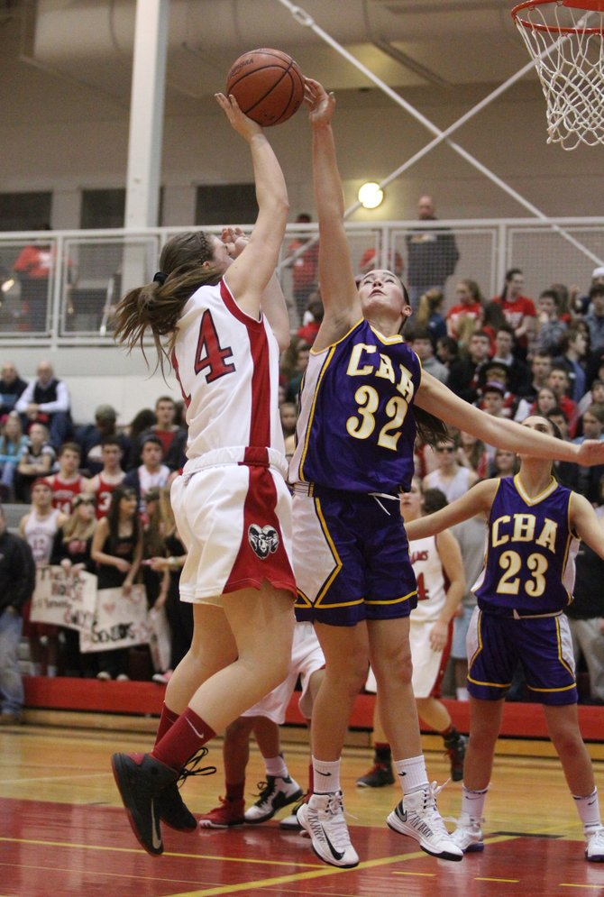 CBA freshman guard Natalie Nardella (32) goes up to block a shot by Jamesville-DeWitt's Alyssa Robens (14) in Friday night's game. Nardella also had a career-high 13 points to help the Brothers prevail, 43-37, and give the Red Rams its first defeat of the season.