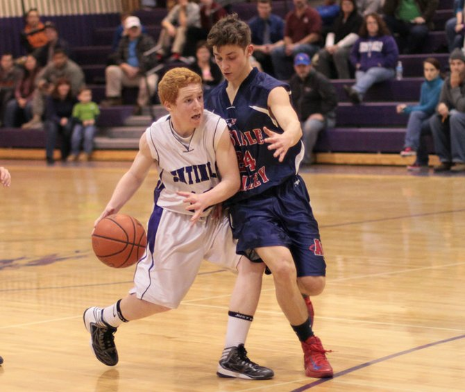 Mark Donohue of Ticonderoga looks for a lane to the hoop.  The Sentinels lost to AuSable Valley, 57-55, in overtime in Champlain Valley Athletic Conference boys basketball action Jan. 10.