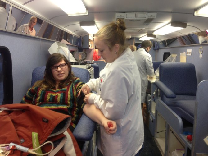 Courtney Clickner, 18, gives blood for the first time during January's National Volunteer Blood Donor Month.