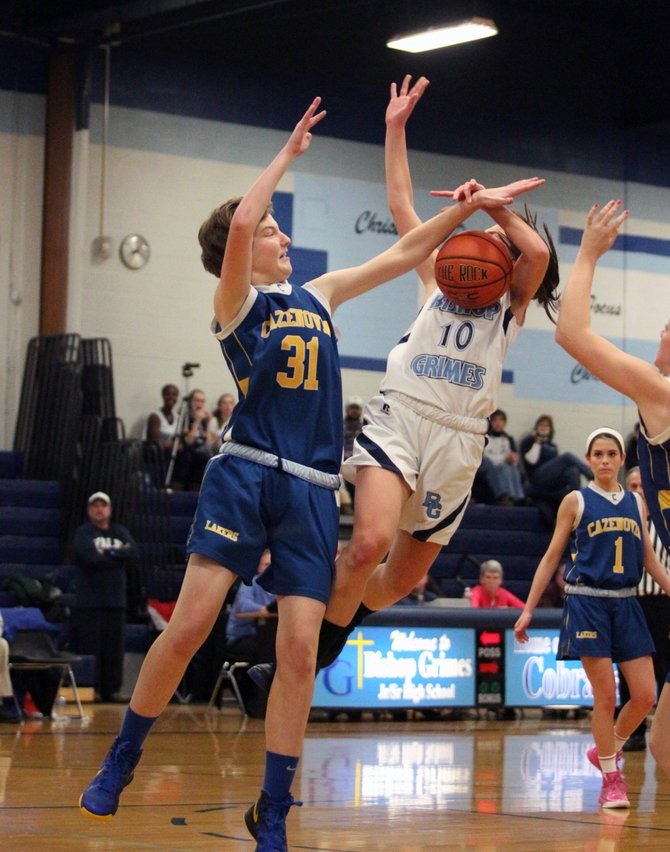 Cazenovia sophomore forward Maggie Johnson (31) blocks a shot attempt by Bishop Grimes&#39; Tina Hoag (10) in Monday night&#39;s game. Johnson and the Lakers defeated the Cobras 43-35, improving its record to 10-2.