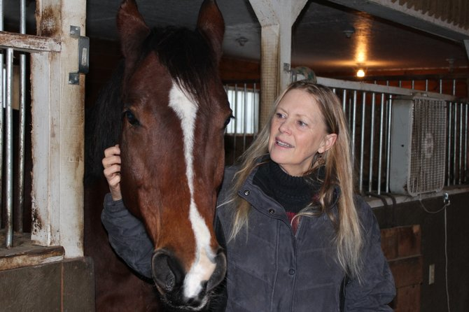 "Katherine Call-Morin, pictured here with Charlie, a Canadian sport horse, wrote ""Heart of a Horse"" to inspire others to be compassionate toward animals."