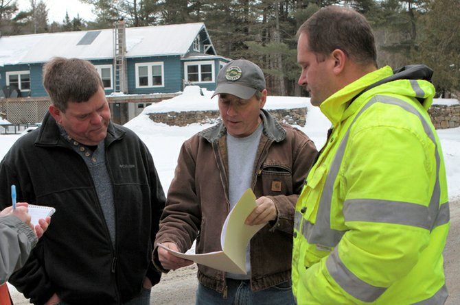 Ticonderoga trustee Wayne Taylor, town water and waste water superinetndent Tracy Smith and Ti deputy water and waste water superintenent Derrick Fleury discuss a test well for Ticondeorga's planned water system upgrade. The first test well is located on Hall Road in Chilson.