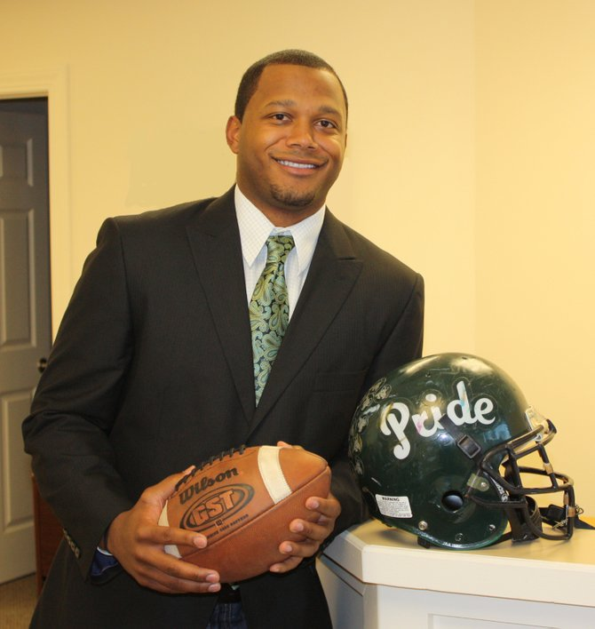 Damien Rhodes was just named as the new varsity football head coach at Fayettville-Manlius, this after spending five years as an assistant at his alma mater. As a player, he led the Hornets to its last Section III Class AA title in 2001 before a distinguished college career at Syracuse University.