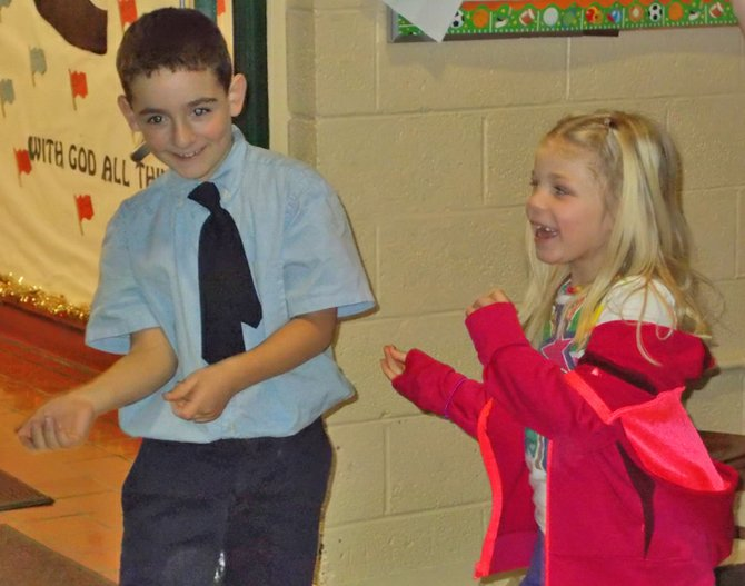 Nicholas Borho and Skylar Barber dance during a performance by Jay Mankita. Mankita taught proper nutrition to St. Mary's School students in Ticonderoga by presenting a concert.