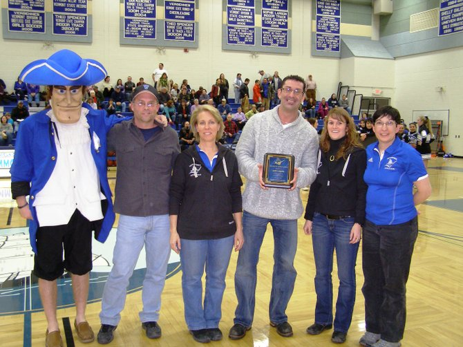 Members of the VUHS Commodore Booster Club presented businessman Brett Ward with a plaque in appreciation for his efforts in supporting the school.