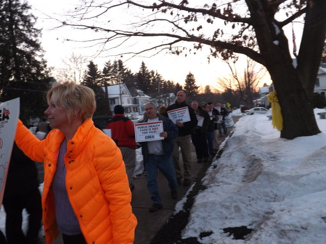 Angry citizens protest Maplewood Manor privatization. Photo by Marci Revette