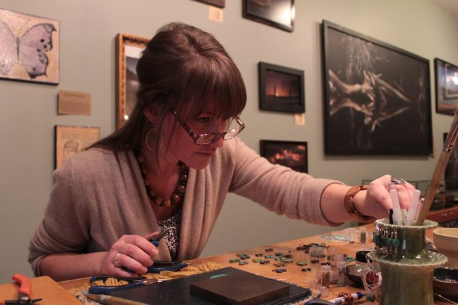 Rachel King, of Earth Girl Designs, crafts some handmade jewelry at Soul Roots Studio in Lake Placid.