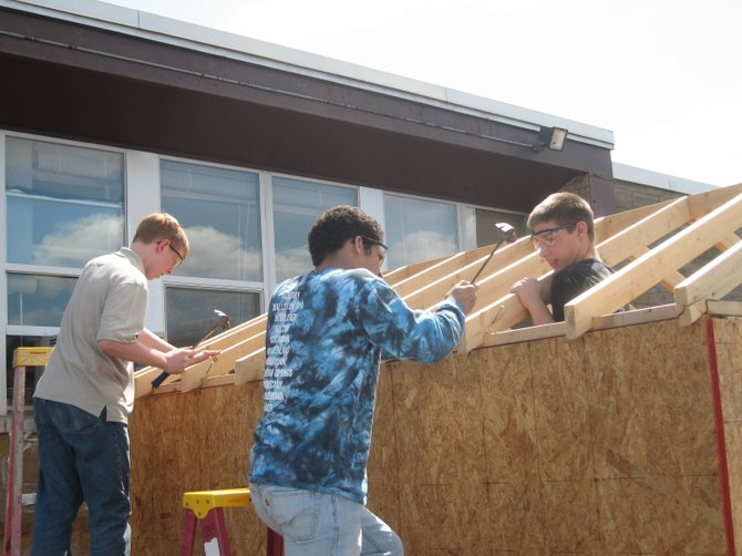 Students in the Colonie Central High School construction classes are building garden sheds available for purchase by the public. The sheds are sized 8 feet by 10 feet, and according to technology teacher John Gehres, they are better than anything you can get at the big box stores.