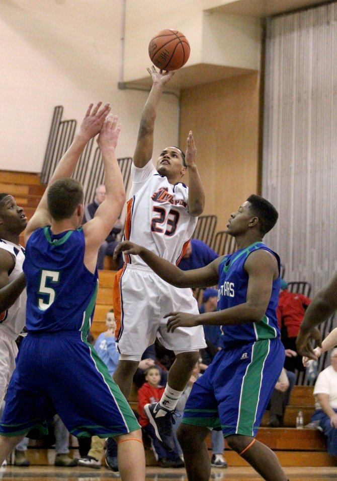 Liverpool guard Jeff Edwards (23) goes over Cicero-North Syracuse's Vince Mallaro (5) and Xavier Brown (1) for a jump shot in Friday's game. Edwards had 15 points, including four 3-pointers, as the Warriors beat the Northstars 78-64 and completed a regular-season sweep in this neighborhood rivalry.