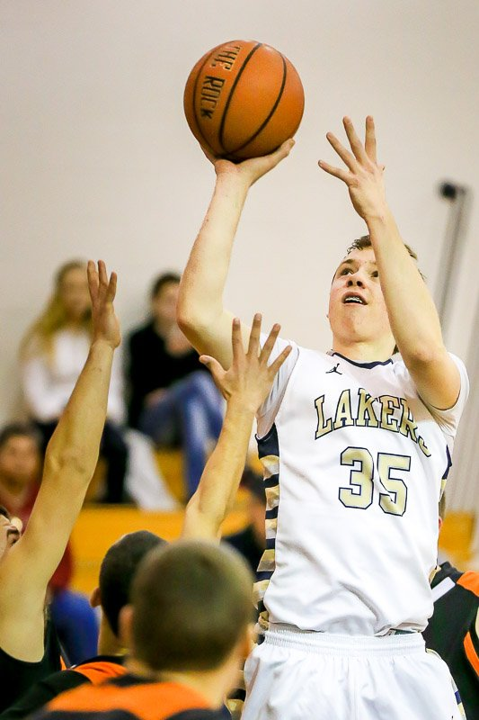 Skaneateles guard Bobby Leslie (35) goes up for a one-handed shot in Friday night&#39;s game against Phoenix. Leslie led the Lakers with 18 points as it beat the Firebirds 62-58 to improve to 8-4 on the season.