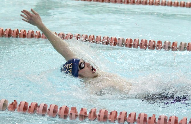 West Genesee boys swimmer Jake Mullett competes in the backstroke leg of the 200 medley relay during Fridays meet at Liverpool, The Wildcats took a 103-76 defeat to the Warriors.