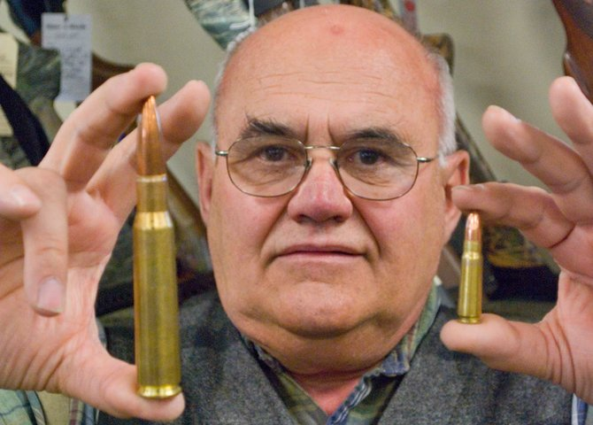 Dick Phillips, owner of Vermont Field Sports in Middlebury, holds up large caliber bullets during an ammo shortage in early 2009. The shortage was triggered by the first election of President Obama. Vermont gun sellers are seeing a brisk trade in guns and ammo following threats by Obama, and others, for stricter gun controls that many say threaten the Second Amendment.
