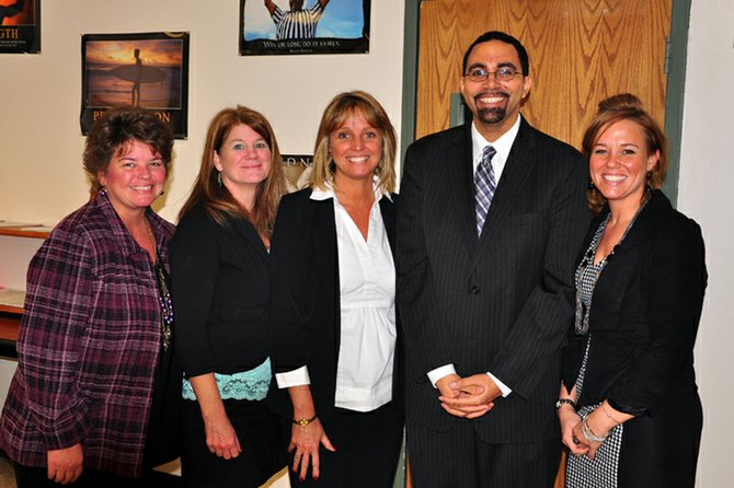 Crown Point Central School was selected to make a presentation to John King Jr. state education commissioner, during his recent tour of the North Country. From left are Crown Point Superintendent Shari Brannock, teacher Lisa Harrington, teacher Jaci Pockett, King and teacher Tara Spaulding.