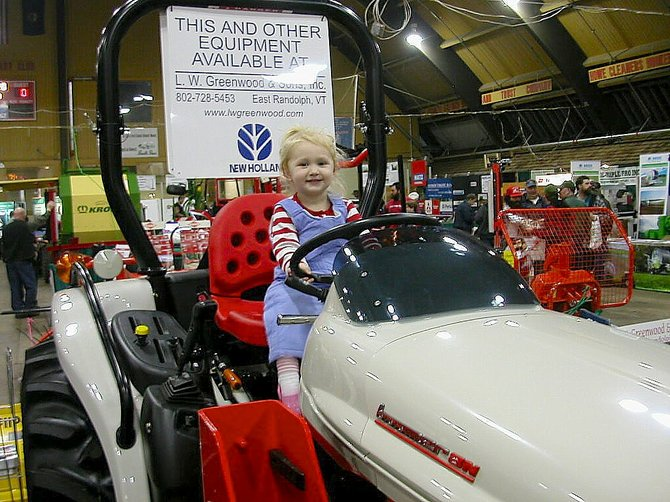 Little Kaly Montross test drives a tractor at last year's Vermont Farm Show at the Champlain Valley Expo. The 2013 Vermont Farm Show at the Champlain Valley Expo runs Jan. 29-31.