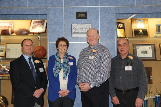 Five athletes and one coach were inducted into the East Syracuse Minoa Athletic Hall of Fame in ceremonies on Jan. 19. From left are members of the fourth induction class: Doug Mohorter (bowling coach), Sue Scheibel (athlete, Class of 1975), Joseph Verzino (football, Class of 1971) and John Vona (athlete, Minoa High School, Class of 1948). Christopher Caso (gymnastics, Class of 1981) and Kate Fontana (lacrosse, Class of 2003) were unable to attend the ceremony.