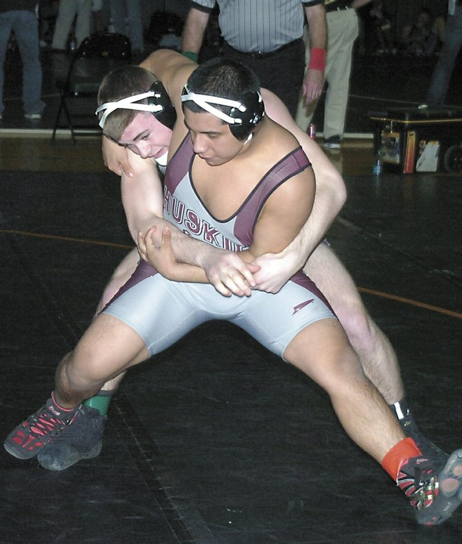 Shenendehowa&#39;s Levi Ashley tries to take down Harrison&#39;s Joe Jimenez during a 195-pound division quarterfinal bout at the Jan. 20 Shen Invitational.