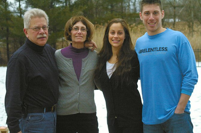 Justin Finkle, far right, has the support of his family — (from left) his parents, Marty and Paula Finkle, and fiancee Rachael Shatsoff — as he heads to Florida this weekend to compete in the Skip Barber Racing School IndyCar Academy. The winner earns a sponsored ride in Barber's regional racing series.