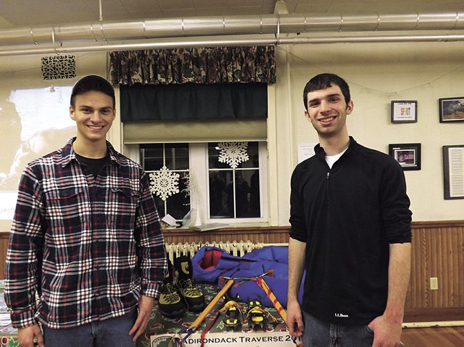 Gabe Messercola and Ryan Wichens posing with their hiking equipment. Photo by Marci Revette