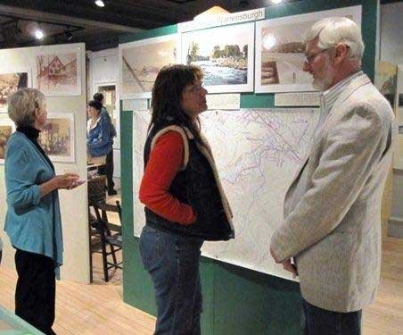 During a reception at the Warrensburgh Museum of Local History, Delbert Chambers (right) talks to a visitor to the popular venue. Due in part to a substantial  increase in visitors this past year, the museum is now seeking volunteer greeters. While Chambers has curated exhibits and has extensive experience related to the museum, prospective greeters aren't required to have experience as docents — just an interest in history and an outgoing attitude.