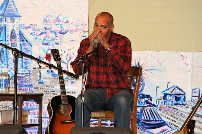 Bluesman Guy Davis marked Martin Luther King Day with a performance at Ticonderoga Elementary School Jan. 22, touching on music, history and race.