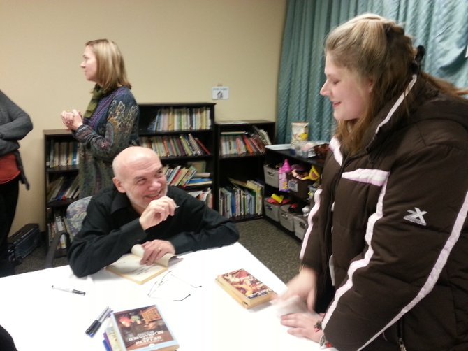 Lauren Schug, 21, chats with Coville after waiting for 45 minutes to get her books signed