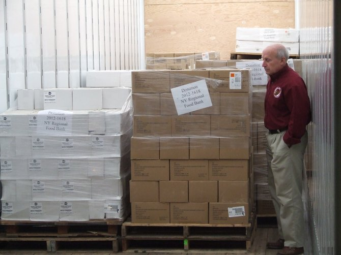 Regional Food Bank of Northeastern New York Executive Director Mark Quandt with 40,000 lbs of donated nonperishable food items.