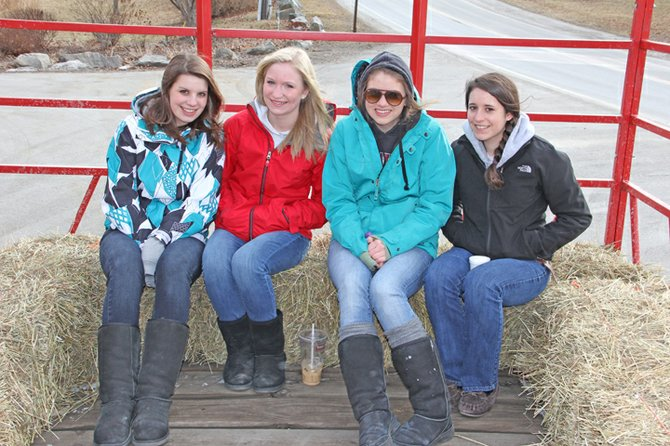 Jaelyn Granger, Katie Palandrani, Grace Ginn and Andrea Rich enjoy a hay ride at the 2012 WinterFest in Ticonderoga. Despite the lack of snow, festivities went on. The 2013 WinterFest will be Feb. 9.