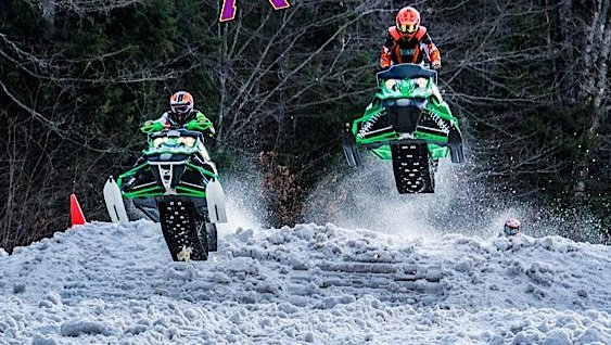 Two competitors in the East Coast Snocross races held recently at Burke Mountain, Vt. fly off a jump to the delight of spectators. East Coast Snocross is holding a series of races Saturday Jan. 26 and Sunday Jan. 27 in Lake George Village at the Charles Wood Park off West Brook Road.