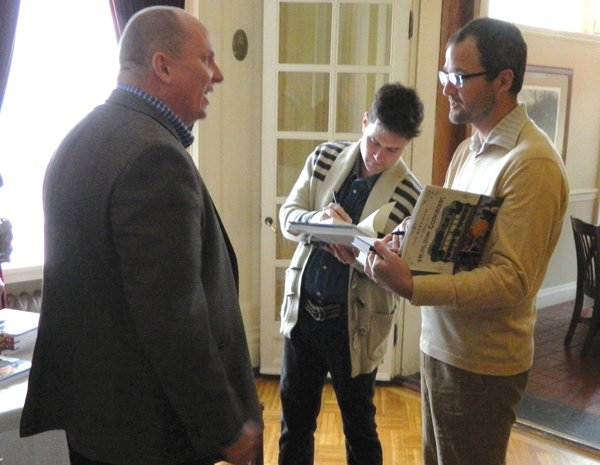 "Tom Tait, of Cazenovia, left, gets copies of ""The Beekman 1802 Heirloom Cookbook"" signed by Josh Kilmer-Purcell, right, and Brent Ridge, also known as ""The Fabulous Beekman Boys,"" during a special signing held Jan. 26 at the Lincklaen House. Afterwards, the ""Boys"" strolled downtown and then celebrated Burns Night 2013 at the Brae Loch Inn."