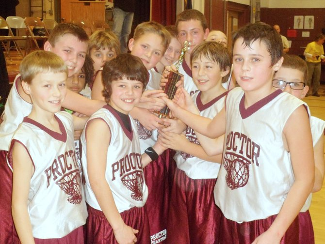 West Rutland School's fifth and sixth grade boys basketball team celebrated its first place trophy at the Bob Ward Tournament held in Rutland County recently. Photo courtesy of Stacy Keny