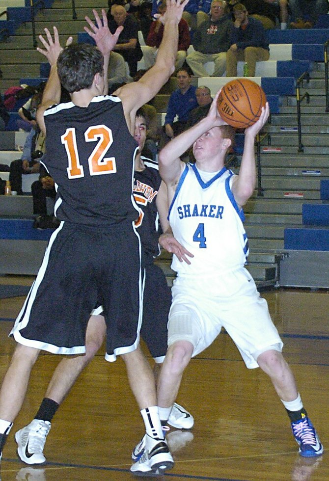 Shaker's Andrew Holmes faces two Bethlehem defenders during a Jan. 25 Suburban Council game in Latham.