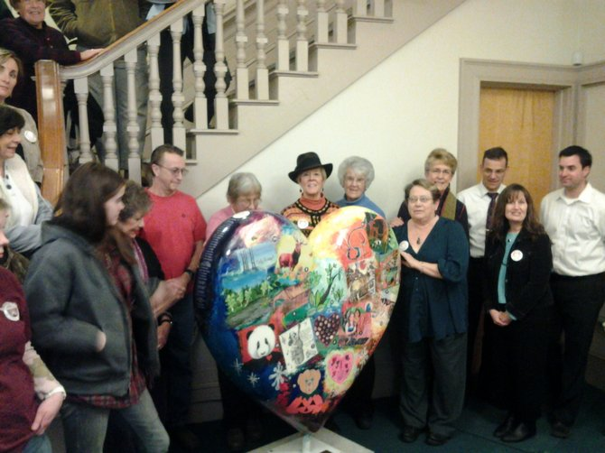 Rutland Mayor Chris Louras, city officials, local artists, sponsors, committee members and friends gathered downtown last week to dedicate a special heARTS heart to the City of Rutland. This giant plastic heart features graph work from all of the artists who were involved in painting the original 30 hearts seen around Rutland; it represents the heARTs of Rutland project which celebrates Rutland-area pride. (New Market Press photo)
