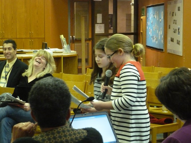 Fifth-grade Eagle Elementary students Ava Navarro and Cece Amory presented to the Board of Education their thoughts on why bottled water should be sold in their school.
