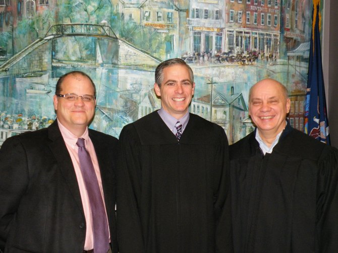 Village of Fayetteville Judge Chris Danaher (center) recently completed his official swearing in by Judge Tom Miller (right) and posed with Mayor Mark Olson (left).