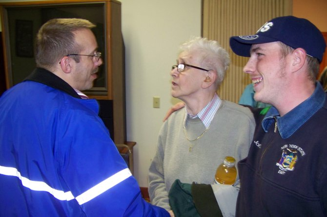 HAPPIER DAYS — At the conclusion of the Thurman Town Board meeting in November, Thurman EMS squad President Jean Coulard (center) and squad captain John O'Neill (right) exchange friendly compliments with Warrensburg EMS Squad Captain Steve Emerson (left). Since then, the Thurman Town Board withdrew its financial support of the Thurman squad, an action which threatened its survival and prompted the agency's decision this week to dissolve. Warrensburg EMS Board of Directors President Robert Farrell said Jan. 29 that his agency's personnel, if available, would now be responding to calls in Thurman, but would need financial support from the town to continue to respond long-term.