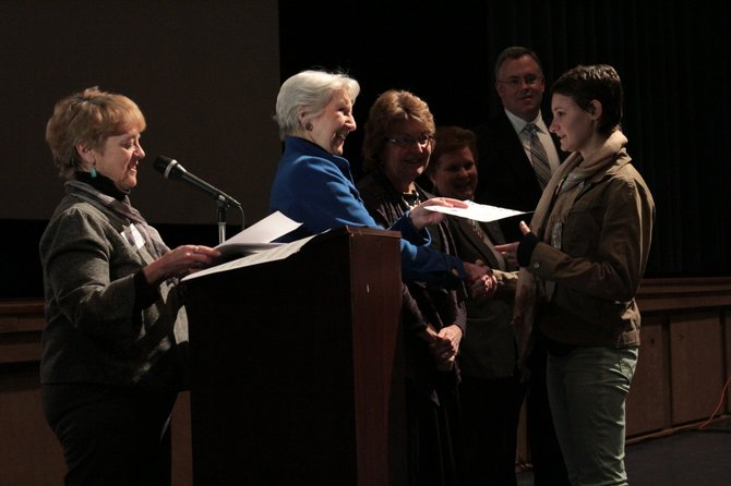 Katie Woltner, the Essex County student delegate picked to go to Albany this spring, shakes hands with the Plattsburgh League of Women Voters president Sally Sears-Mack as (from left) Betty Little, Janet Duprey and Dan Stec look on.
