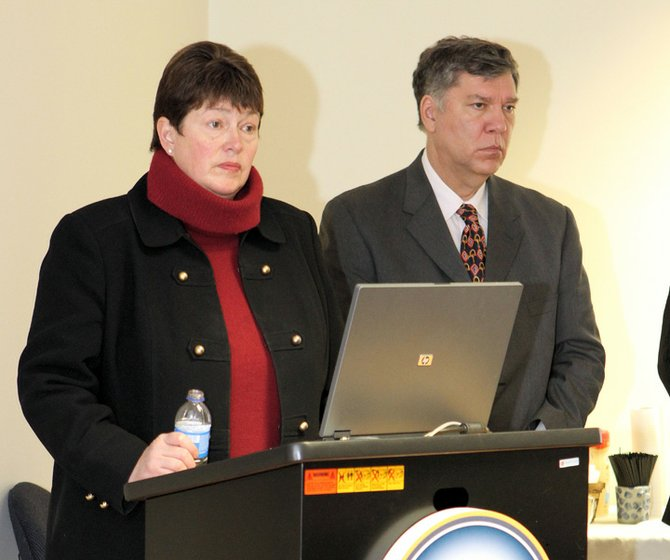 Dede Scozzafava, deputy secretary of state for local government, and Cliff Donaldson, the state Department of Labor commissioner&#39;s North Country regional administrator, meet with people in Ticonderoga to discuss the proposed 2013-14 state budget.