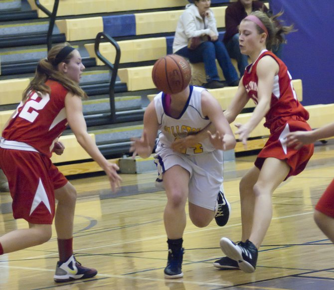 This is Ballston Spa junior Paige Gallo covered by the ball. The Scotties held off a last-quarter push from Niskayuna to win 29-27. 