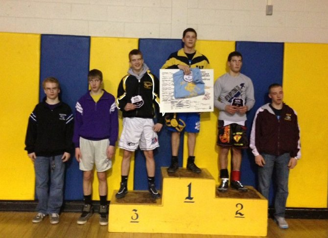 Warrensburg High School athlete Lane Oehler (at top) won the championship title at 132 pounds in the Division II Class 3 Sectional wrestling tournament held Saturday Feb. 2 in Warrensburg. His win and the strong showing of Warrensburgs 12 other wrestlers in the competition propelled Warrensburg to capture third among 13 schools  in the tourney.