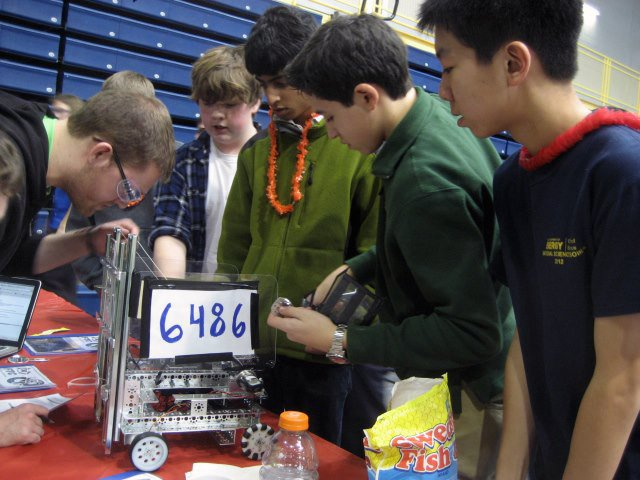 "Niskayuna students on team ""01010100 01000101 01000001 01001101"" make some adjustments to their robot at the regional FIRST Tech Challenge Championship Tournament at Pace University on Sunday, Jan. 27."