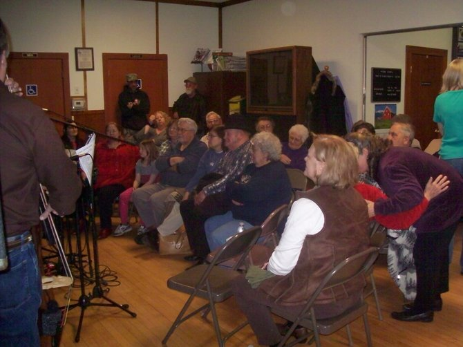 A crowd remained through the 2012 Thurman Jackwax Party to hear Hoddy Ovitt and his Warren County Ramblers play mountain music while others enjoyed the buffet dinner. The audience at this age-old tradition in rural Thurman asked Ovitt to play extra songs well past closing time. The party heralds the onset of spring with the traditional confection of maple syrup ladled onto snow.The 2013 Thurman Jackwax Party is set for 
