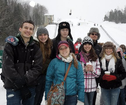Several of the 50 Bolton Central Honor students rewarded with a trip to the U.S. Olympic training facilities in Lake Placid pose for a photo on  one of the training center's ski slopes.