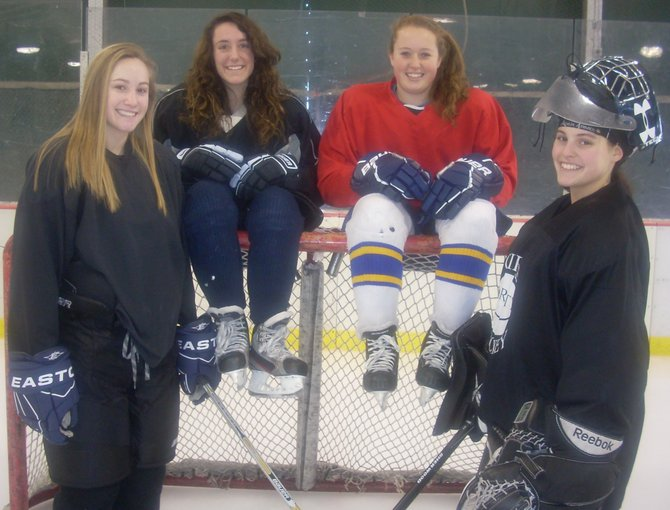 The captains of the 2012-13 Skaneateles High School girls hockey team (left to right) Sarah Sauda, Nora Garrett, Madison Singler and Amanda Lupo. The captains, who were elected by the team, all go to different high schools.